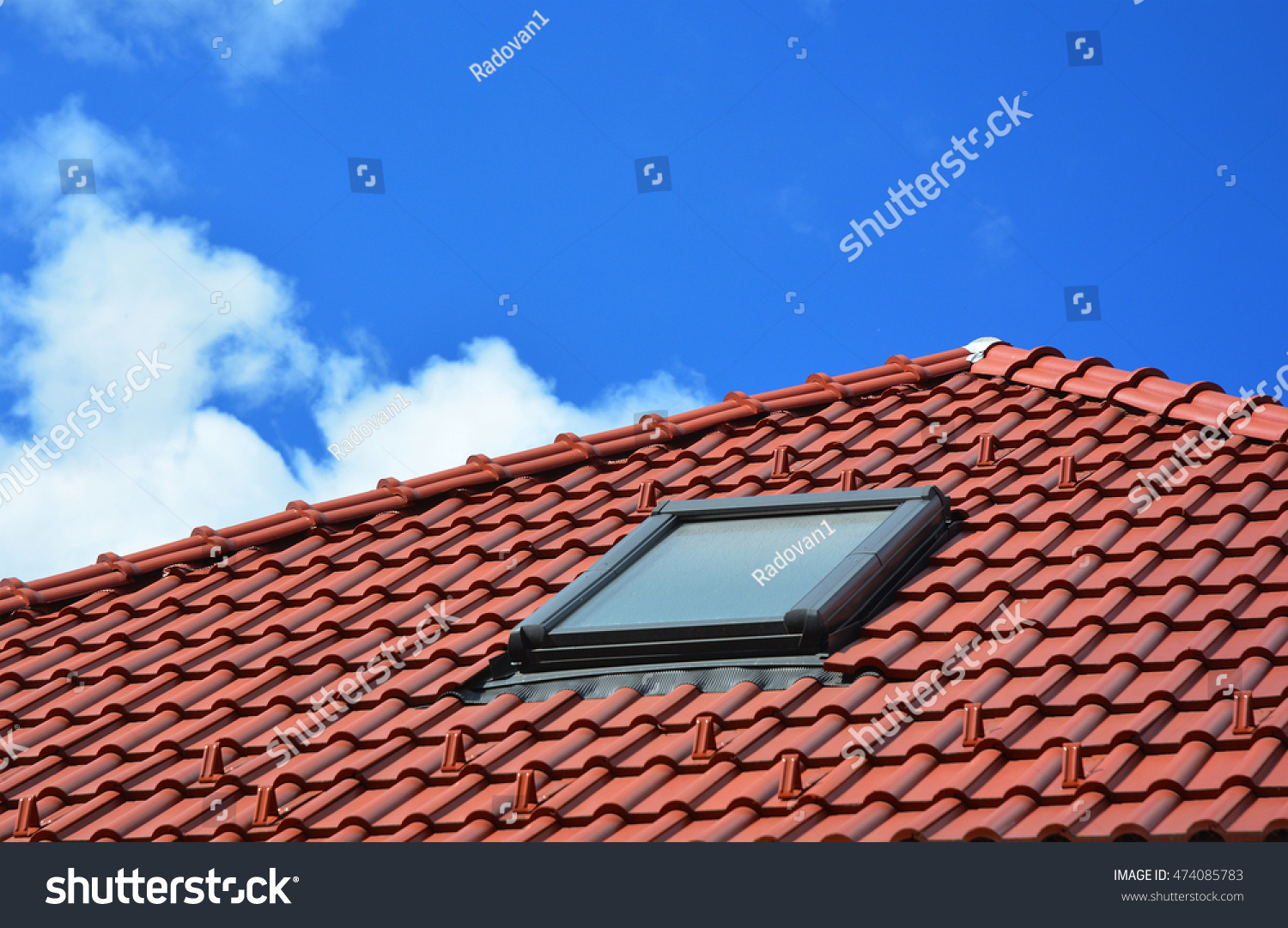 Skylight on red ceramic tiles house stock photo royalty free skylight on red ceramic tiles house roof skylights roof windows and sun tunnels dailygadgetfo Choice Image