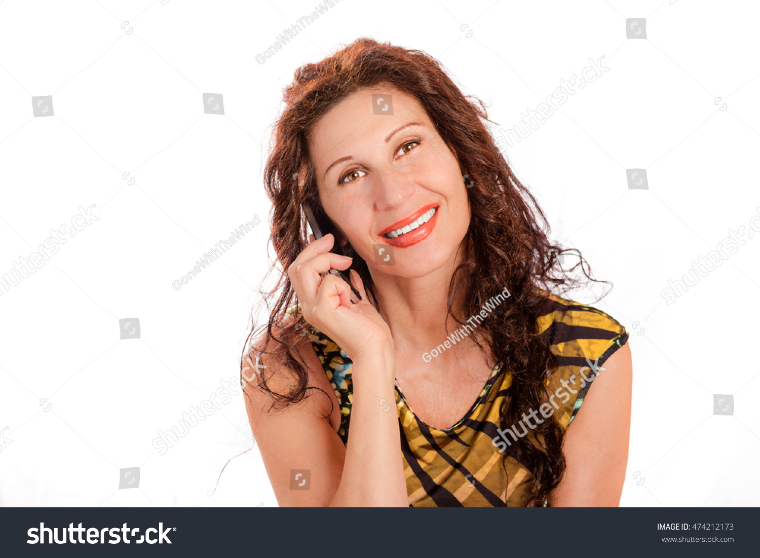 mature classy woman talking on cell phone isolated on white background