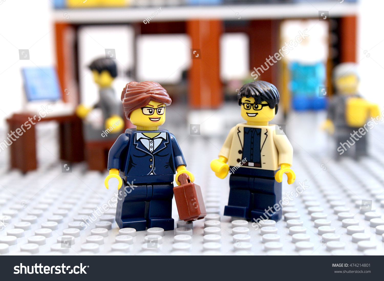 Colorado USA August 26 2016 Studio shot of LEGO minifigure businessman and businesswoman talking at work