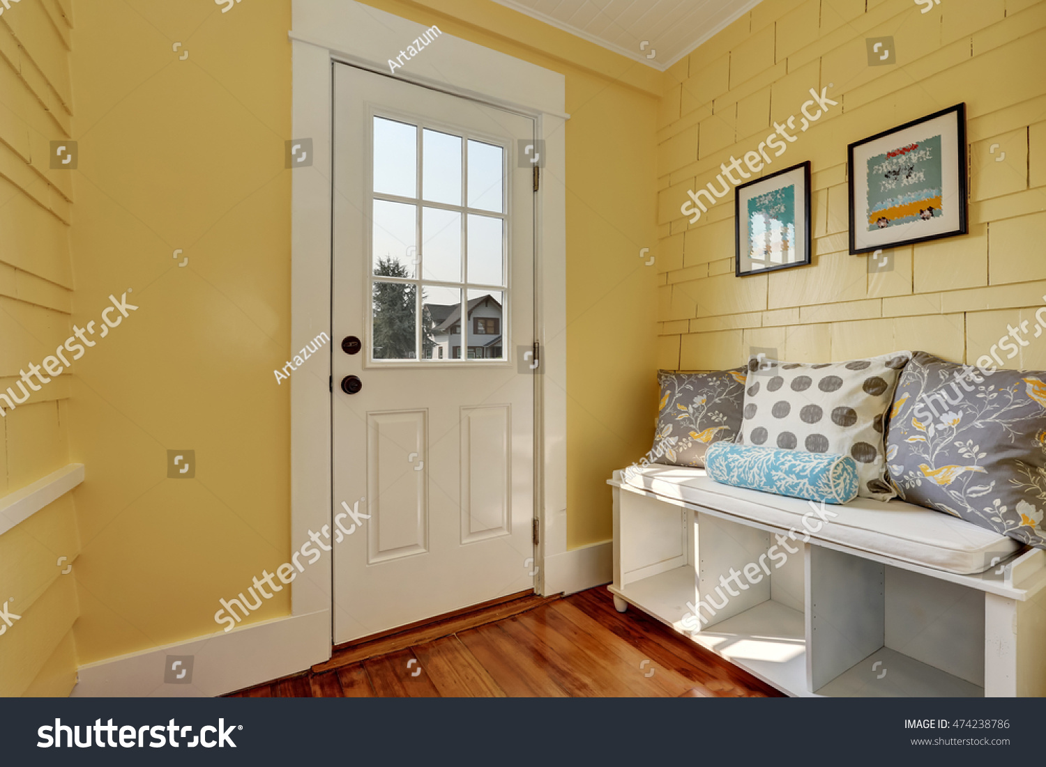 Foyer And Entryways Usa : Entryway yellow walls storage bench white stock photo