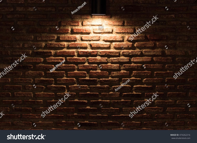light on dark red brick wall stock photo 474262216