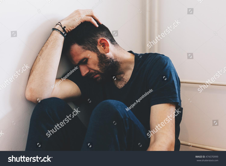 Sad Young Man Sitting Corner Room Stock Photo 474370999