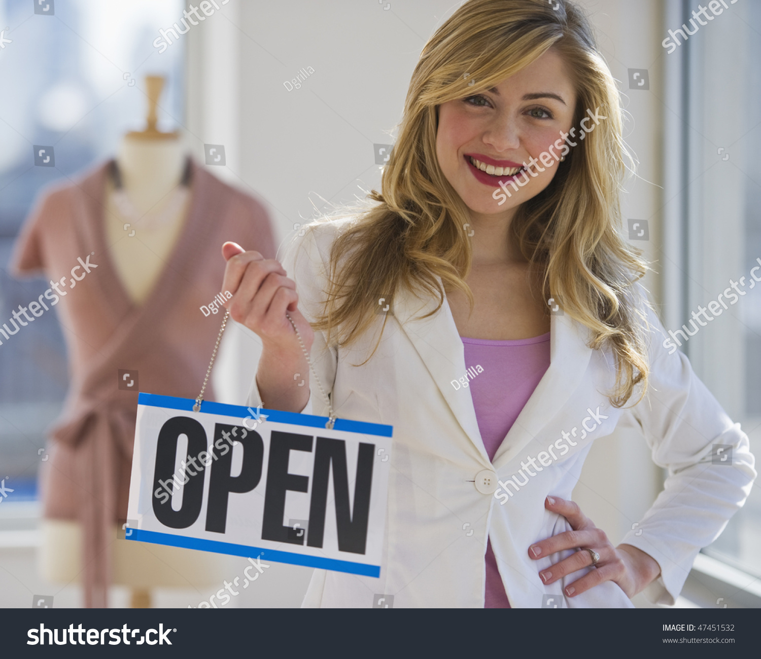 female clothing store worker opening shop stock photo  female clothing store worker opening up shop