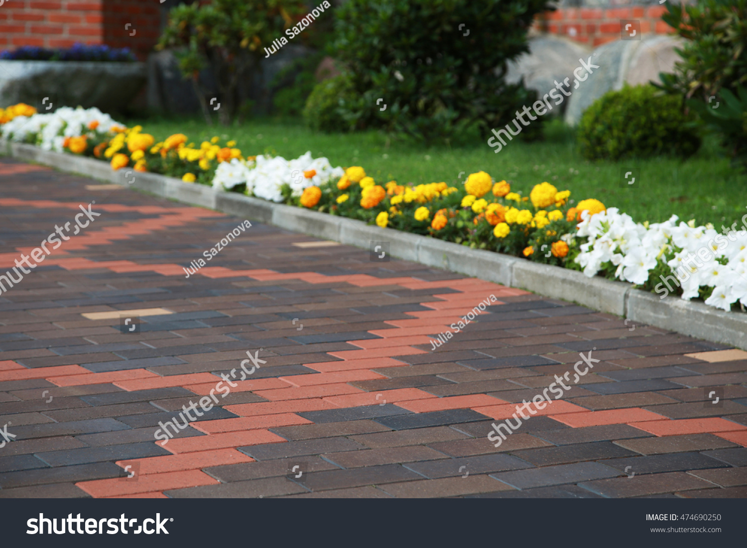 Traditional paving clinker pattern in front of the house  Beautiful garden  design  Illustration for. Traditional Paving Clinker Pattern Front House Stock Photo