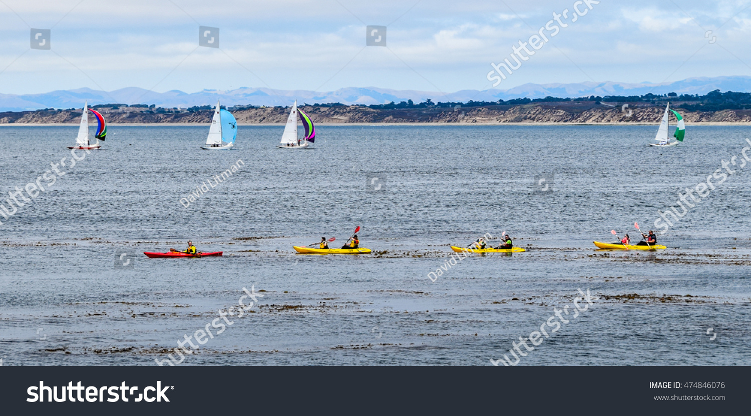 Monterey, California - June 28, 2016: Boaters (sailboats) and kayakers  enjoy their water sports, recreation,  and active lifestyle on a calm summer day on Monterey Bay.