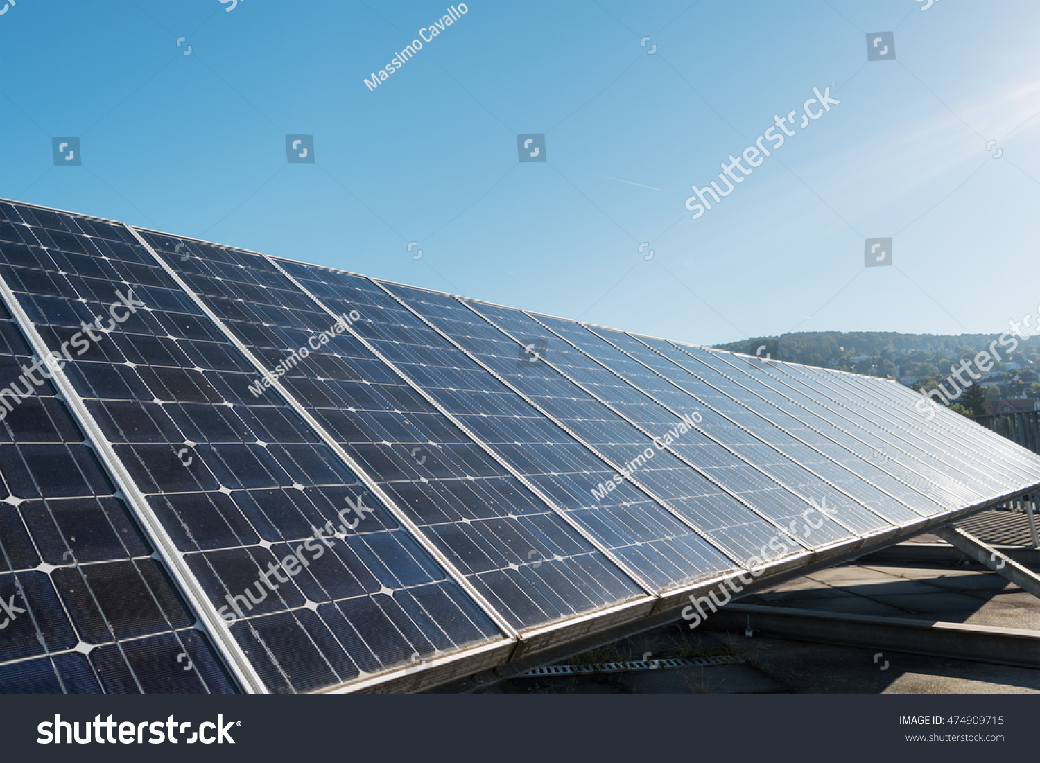 Solar Cell On Roof Top Against Blue Sunny Sky Stock Photo ...