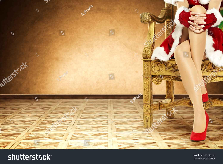 Santa claus woman legs red heels stock photo