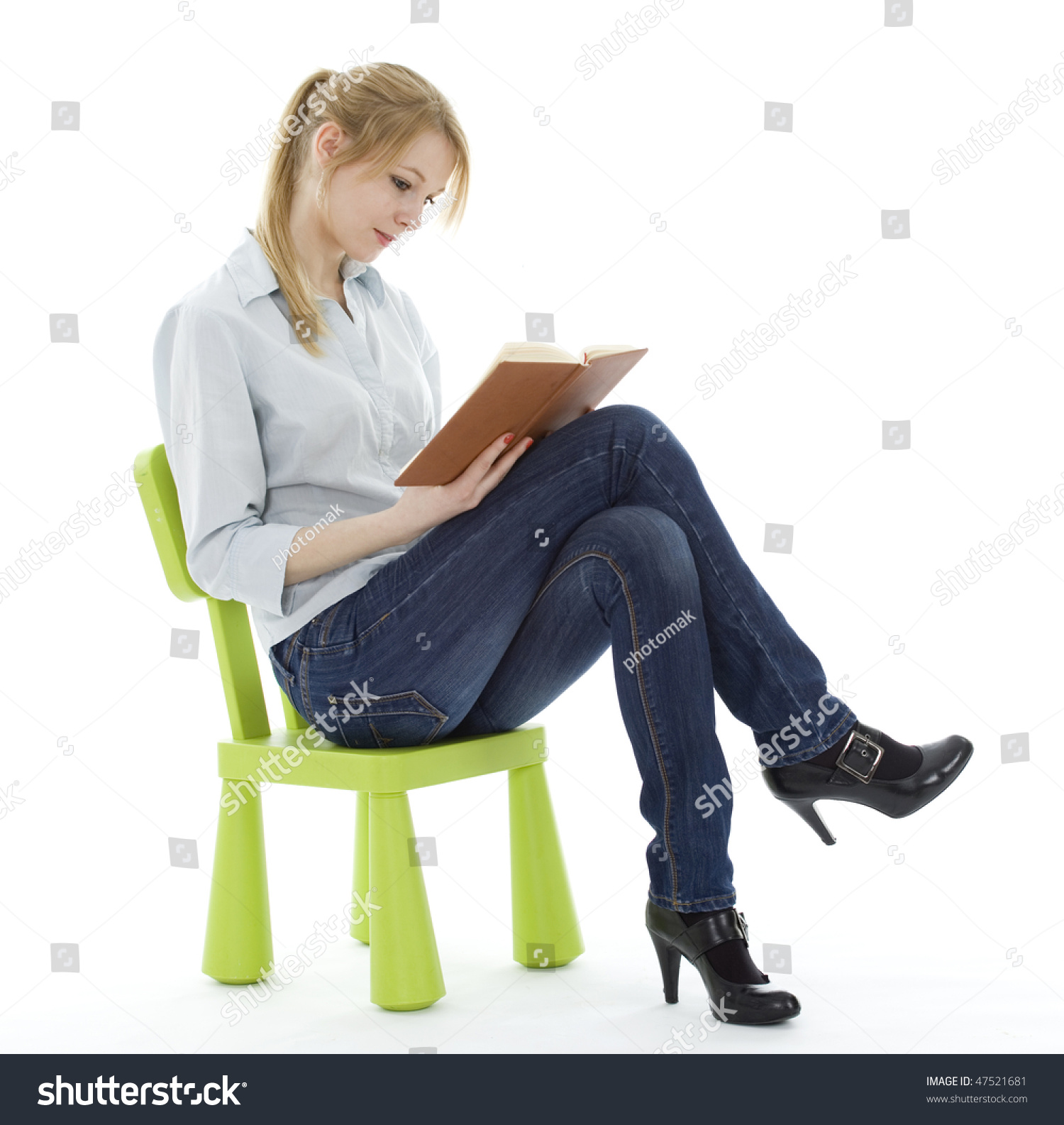 Sitting on green childs chair young stock photo 47521681 for Sitting chairs