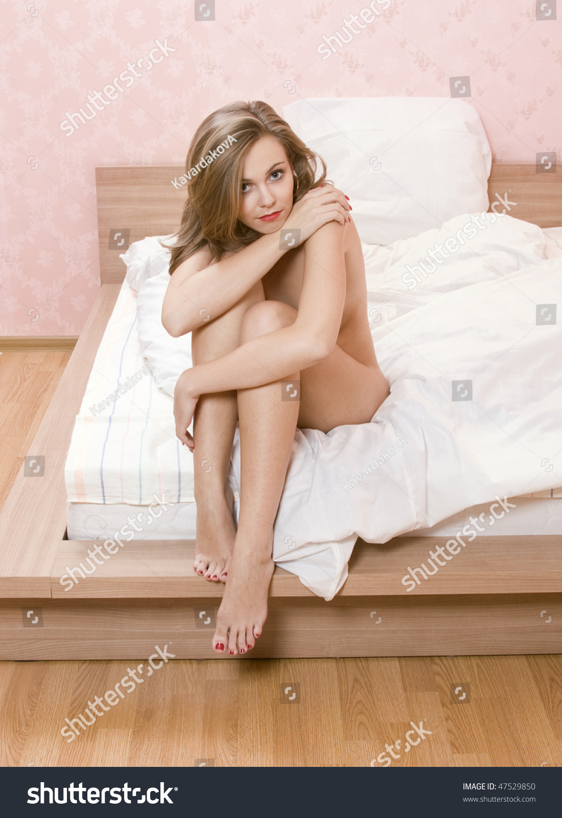 Naked sex in a bed