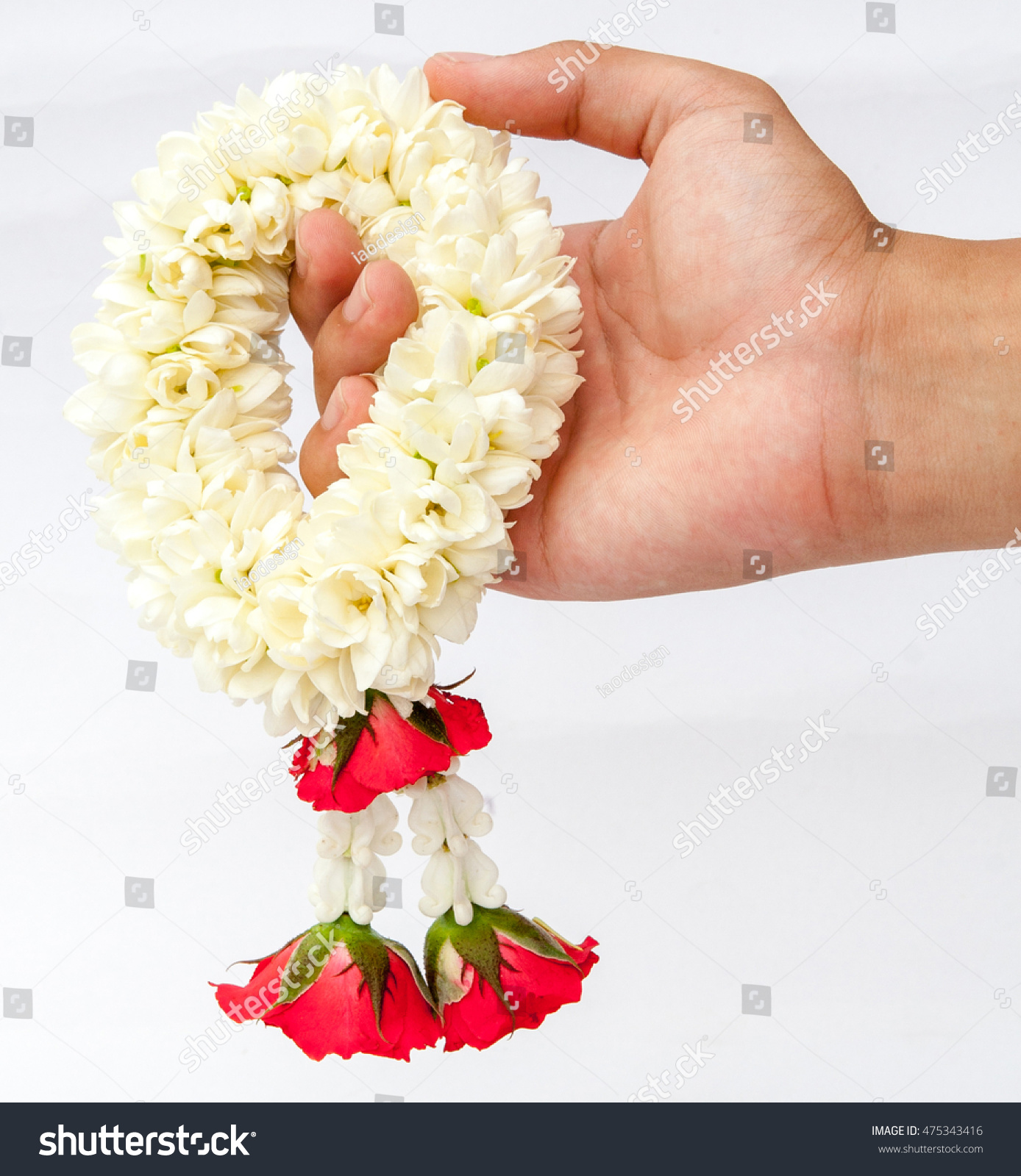 Royalty Free Hand Holding A Flower Garland With 475343416 Stock
