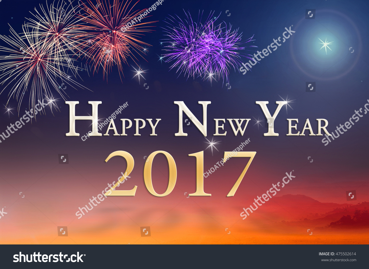 text for happy new year 2017 over fireworks on beautiful nature night background