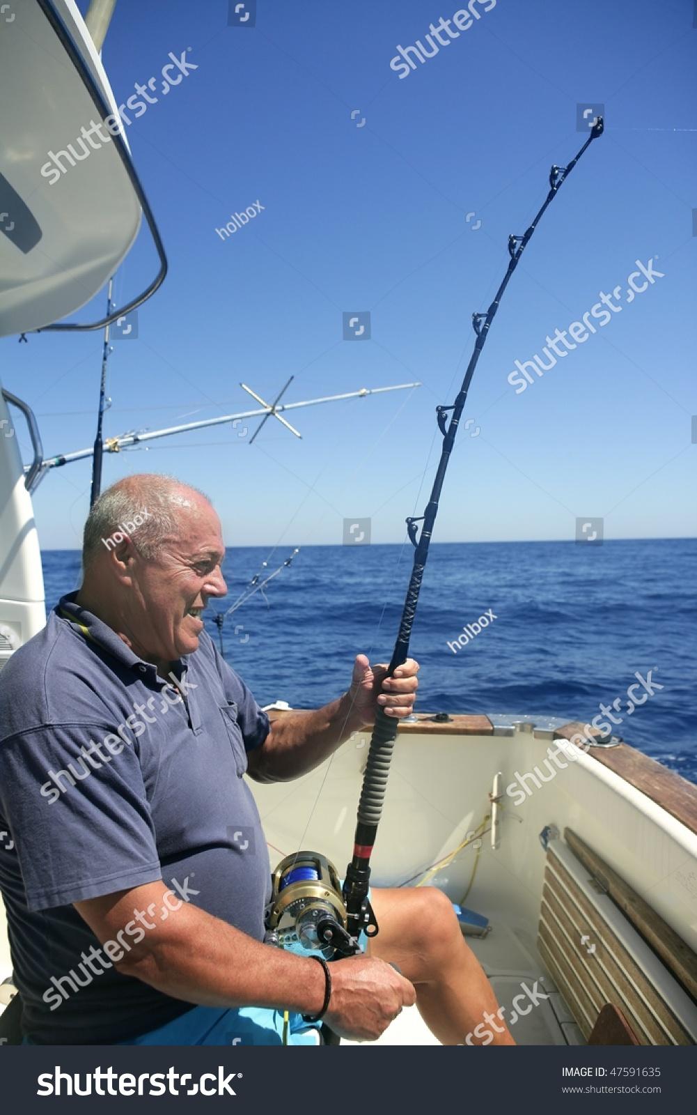 Angler elderly big game sport fishing boat blue summer sea for Sport fishing games
