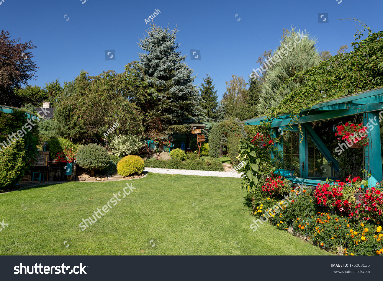 beautiful summer garden design with conifer trees green grass and morning sun cut - Garden Design Trees