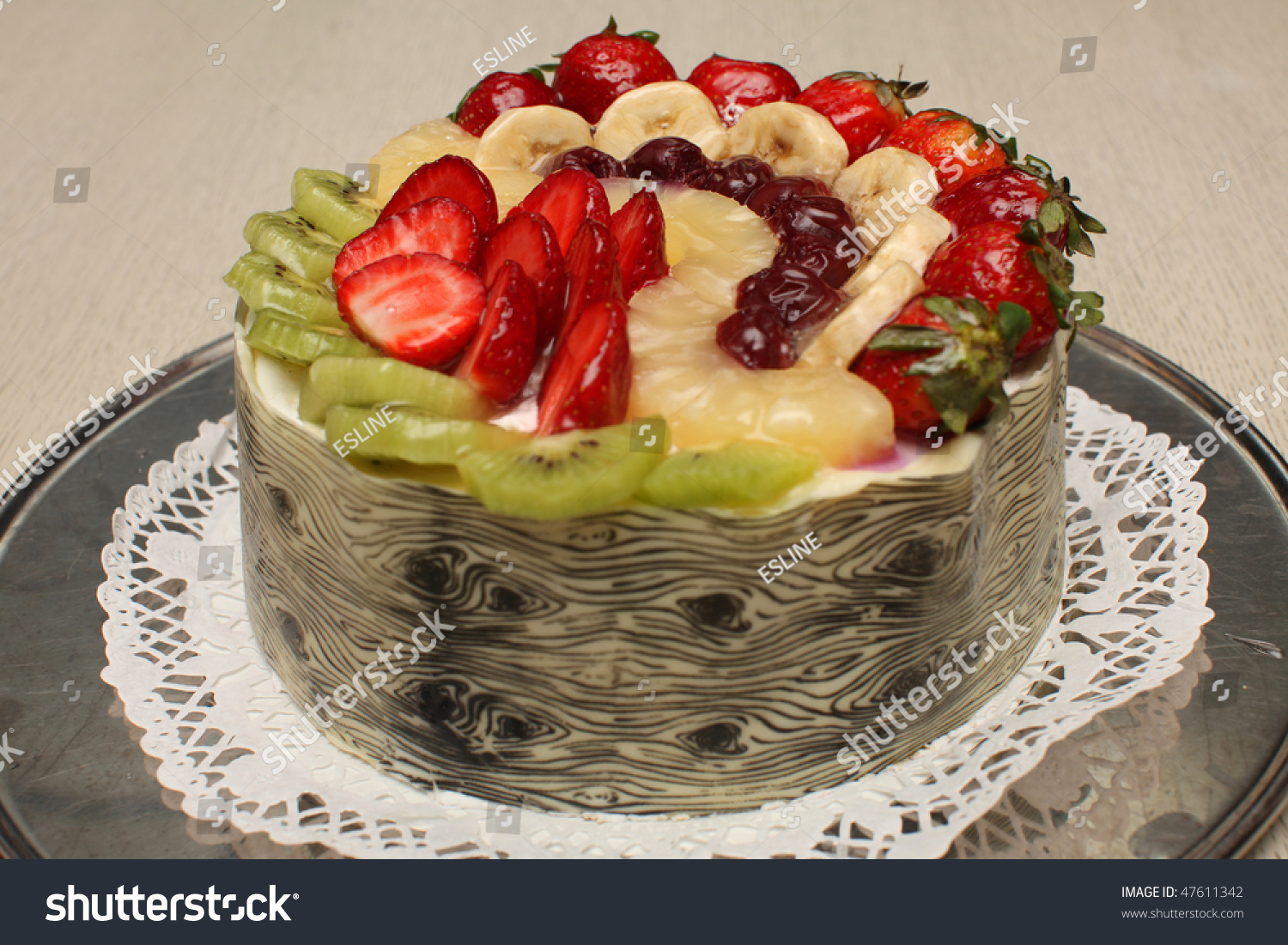 Beautiful Decorated Fruit Cake Surrounded By White ...