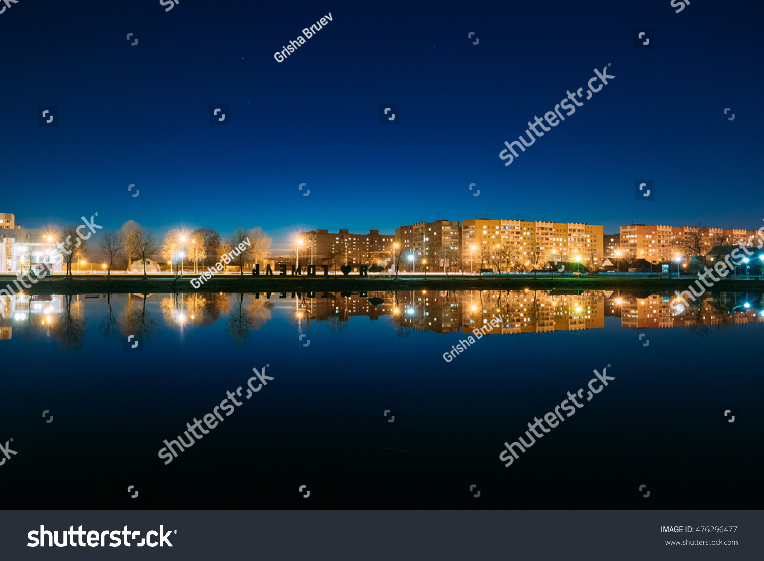 Evening Or Night View Of Urban Residential Area, Overlooks To City Lake In Illumination, Reflecting In Dark Water Surface. Navy Blue Sky Background, Gomel Homiel Belarus #476296477