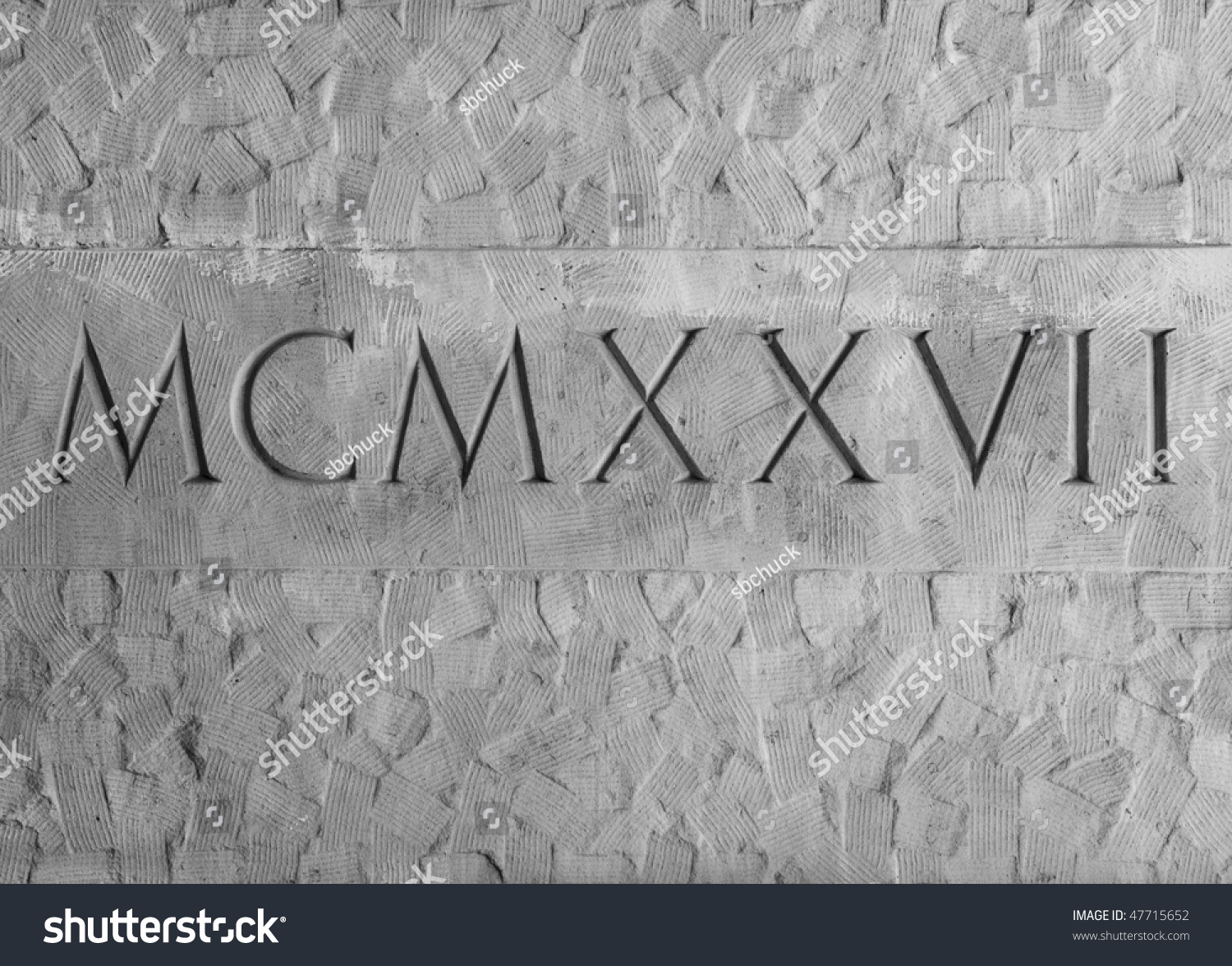 Roman Numerals Engraved In Textured Stone On Outer Wall Of
