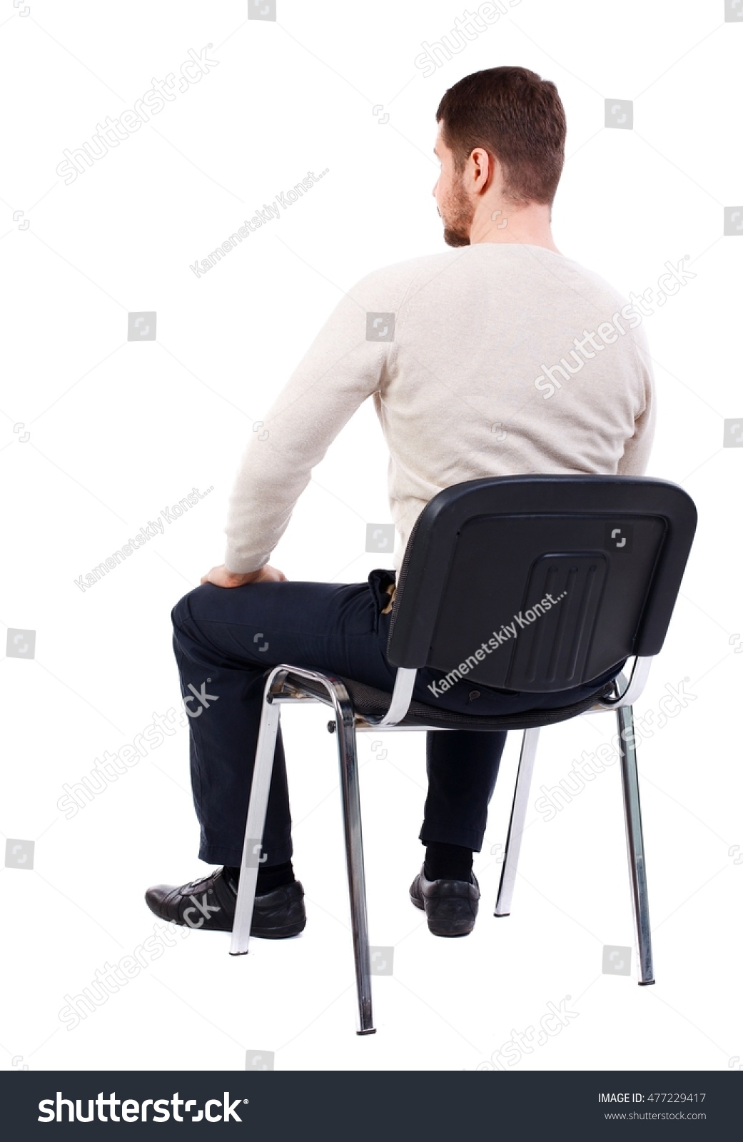 Man sitting in chair side - Back View Of Business Man Sitting On Chair Bearded Man In A White Warm Sweater