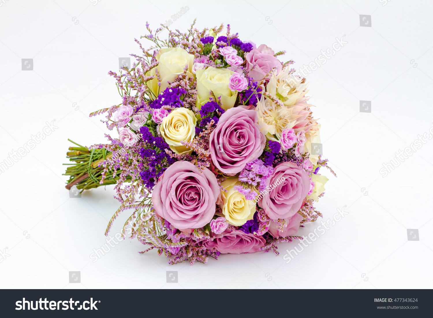 Wedding bouquet made of purple orchids and pink roses isolated on a ...
