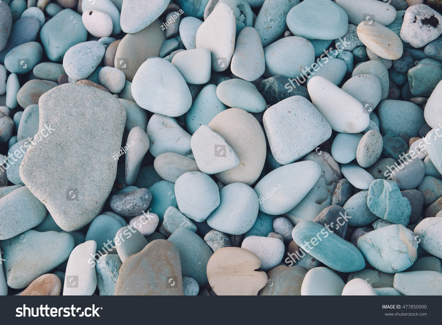 Smooth shaped white stones surface texture background stock photo - Background Texture Of Blue Stones Island Landscape Blue Stone Beach In Flores Indonesia