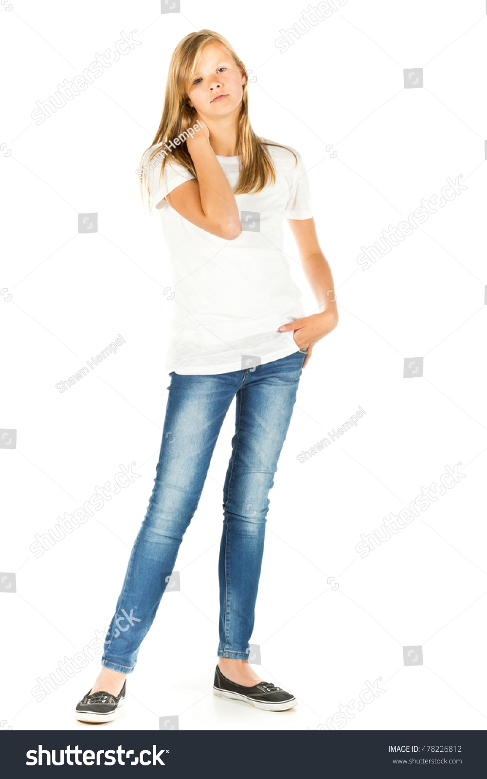 White t shirt blue jeans - Young Girl Standing With White T Shirt And Blue Jeans Over White Background