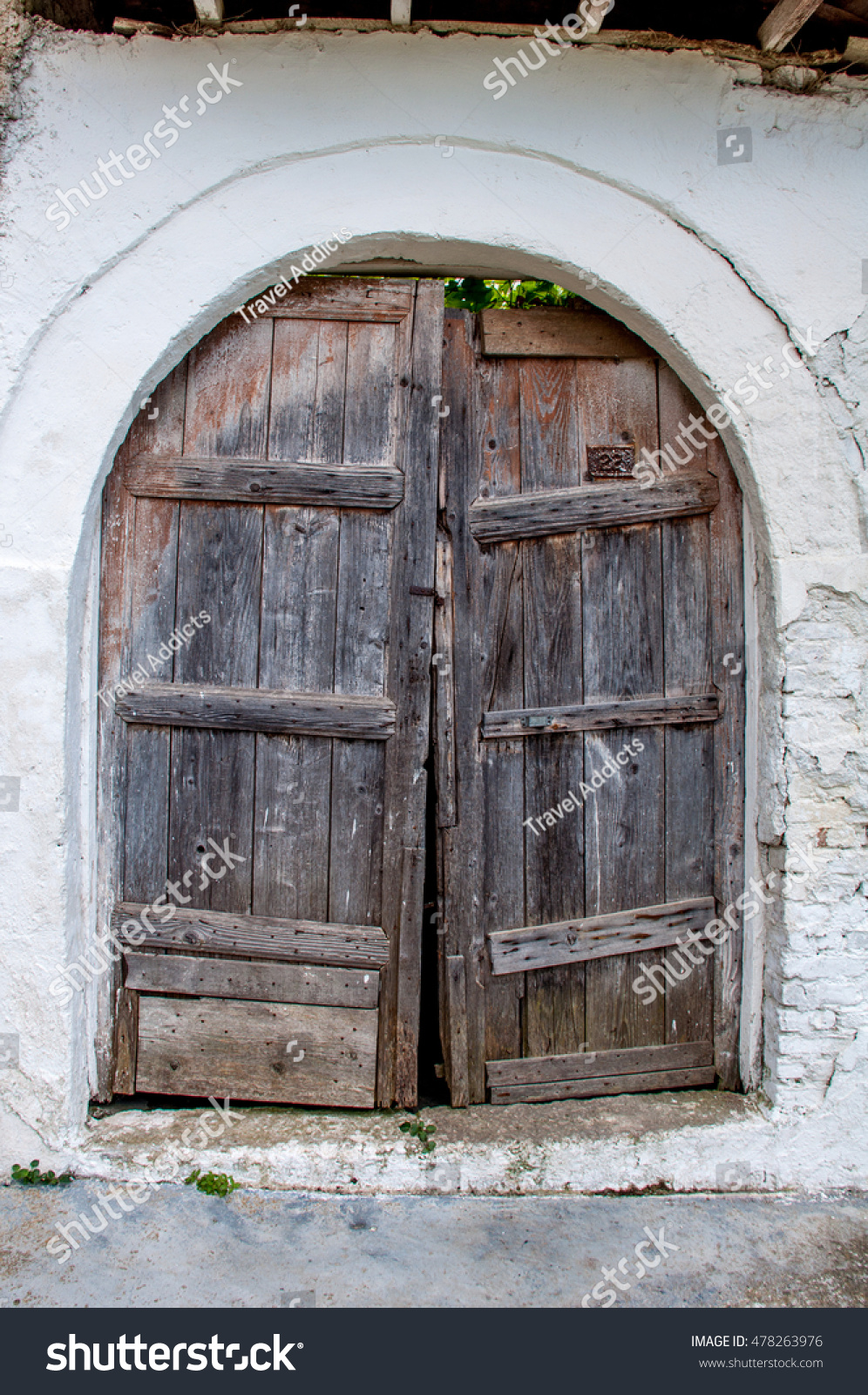 An Old Wooden Door In A Stone Archway. & Stone Door Archways u0026 Large Round-topped Wooden Front Door In ... pezcame.com