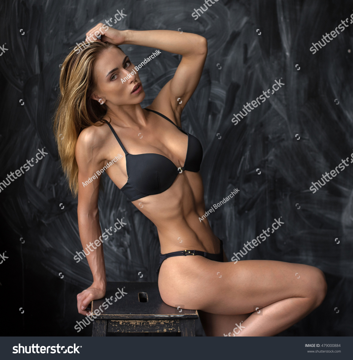 Stock photo beautiful young athletic girl in underwear with spanish looks  on a dark background jpg e99e4da30