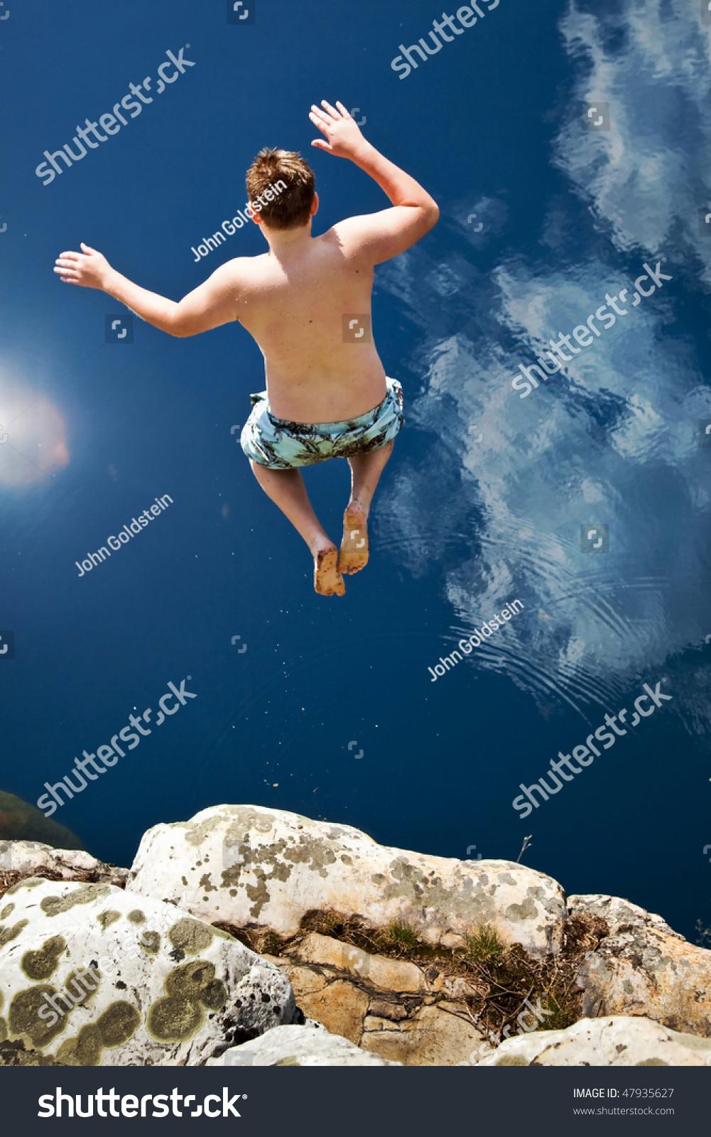 Boy Jumping Off...