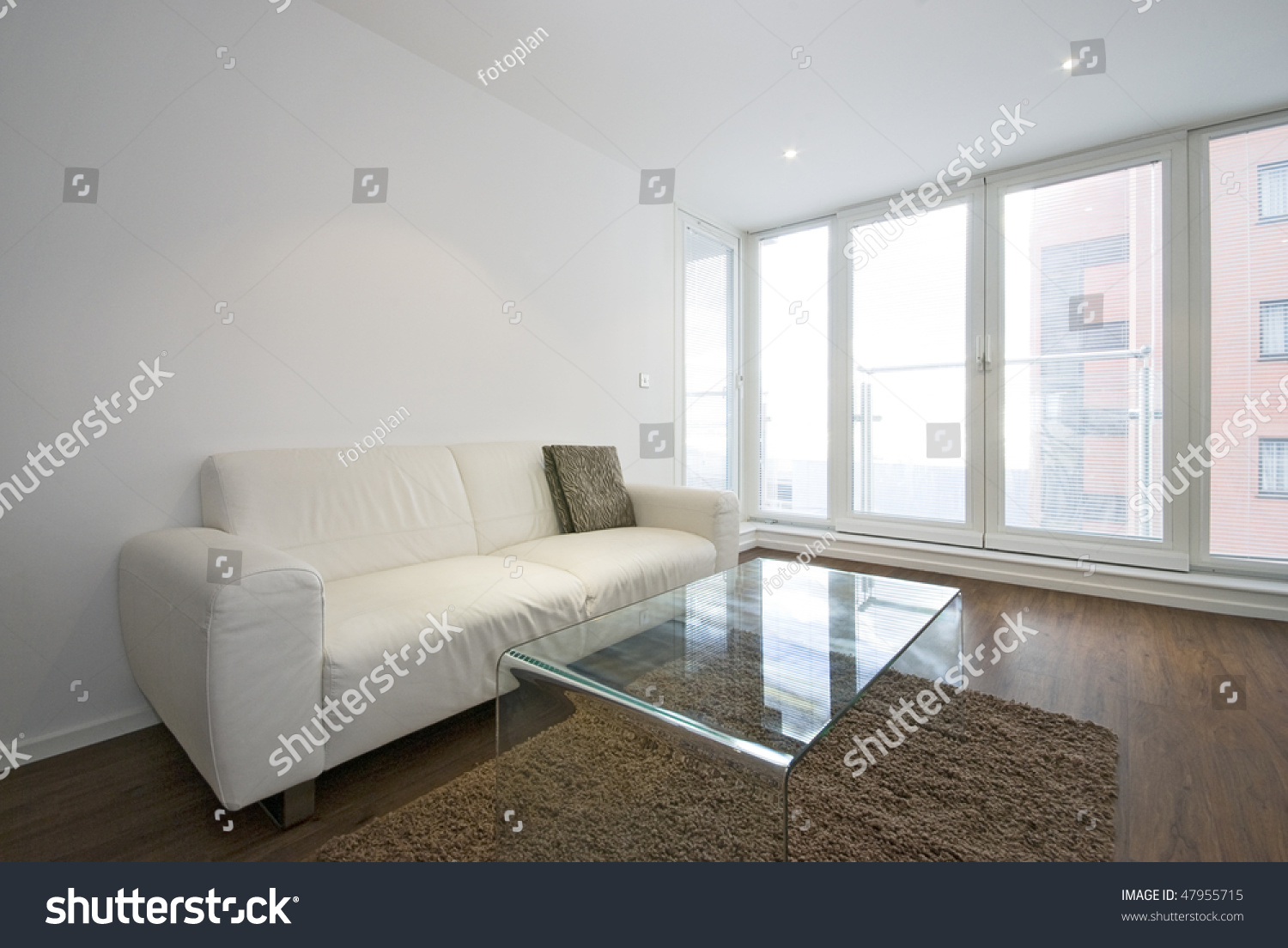 Two Seater Sofa Living Room Modern Living Room With White Leather Two Seater Sofa And Glass