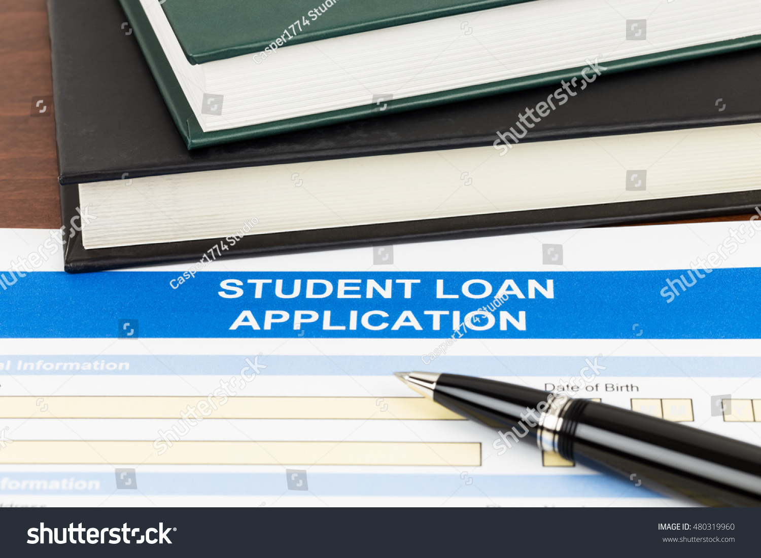 Student Loan Application Form With Pen And Text Book