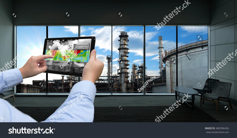 industry 40 concept hand holding tablet stock photo. Black Bedroom Furniture Sets. Home Design Ideas