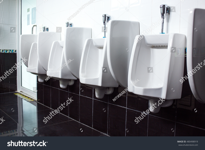 Modern restroom interior urinal row men stock photo edit now
