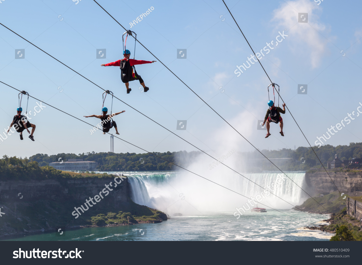NIAGARA FALLS ONTARIO CANADA SEPTEMBER 4 Four people taking zipline ride at Niagara Falls in summer on Sep 4 2016 Ontario CanadaNew zipline in Niagara Parks opened in the summer of 2016