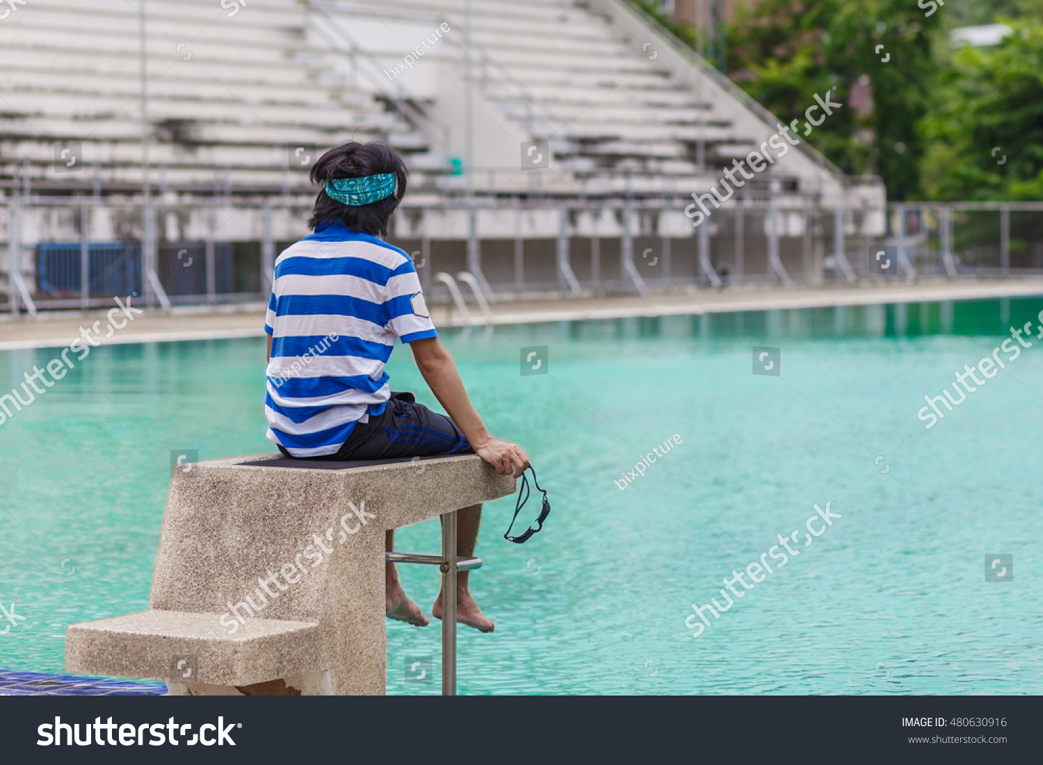 Young Man Sitting On Starting Point Stock Photo (Edit Now ...