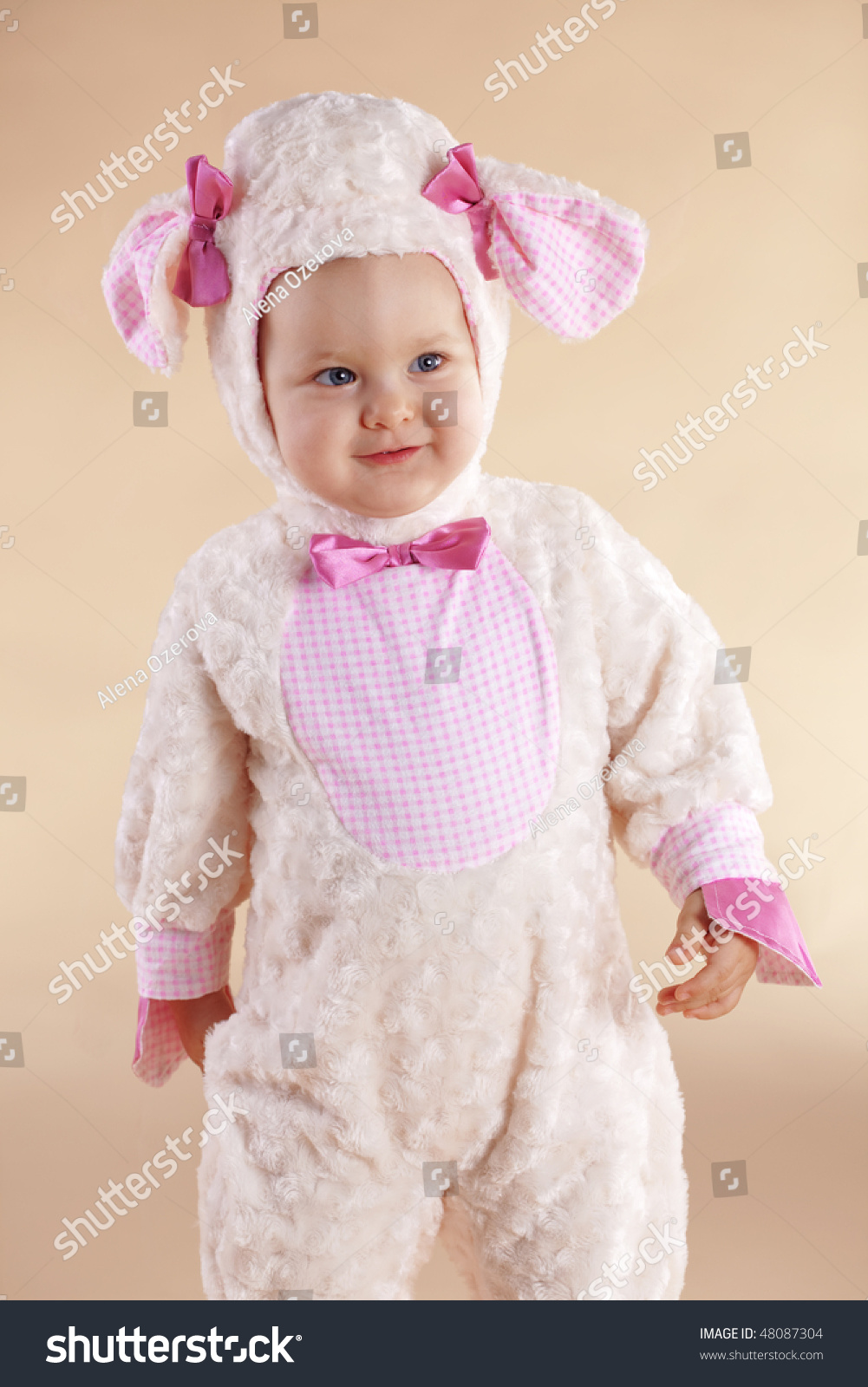 very cute baby wearing sheep costume stock photo (100% legal