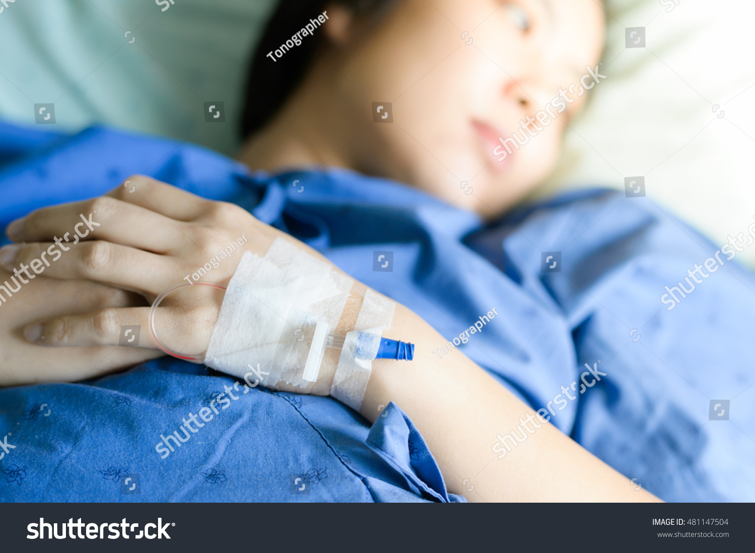 Water bed for patients - Closeup Saline Water Line At The Hand Of Patient On Bed In Hospital Room Infusion