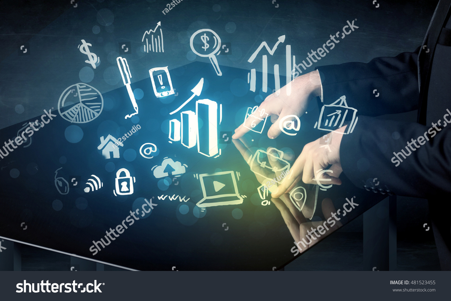 Man touching technology smart table with business icons and symbols ...