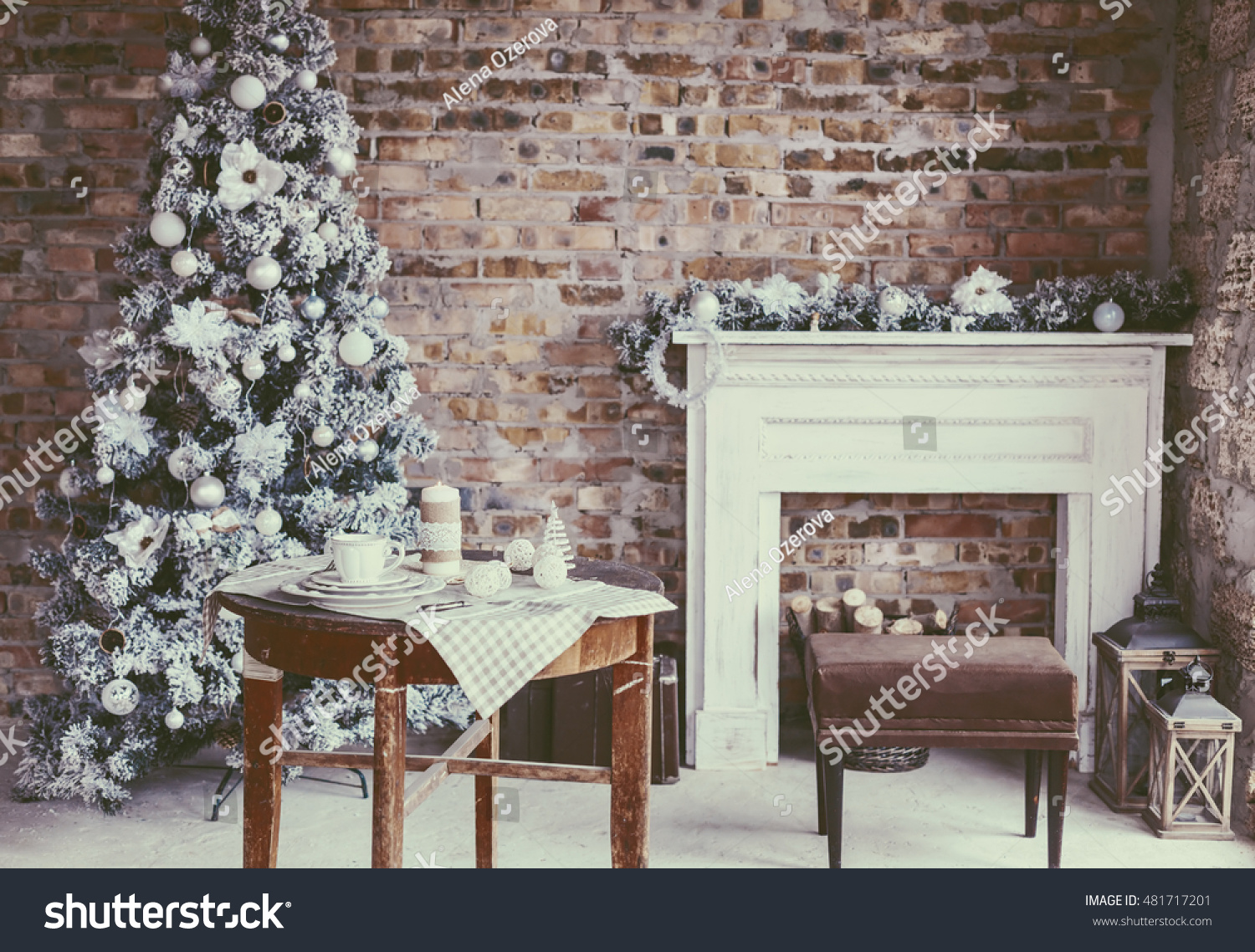 Winter home decor. Christmas tree in loft interior against brick wall. Old  vintage furniture