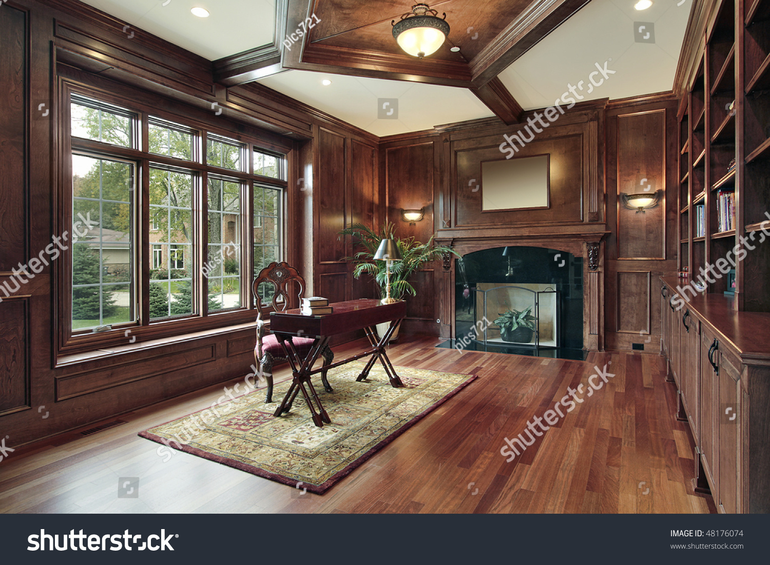 Elegant library luxury home black marble stock photo for Luxury fireplaces luxury homes