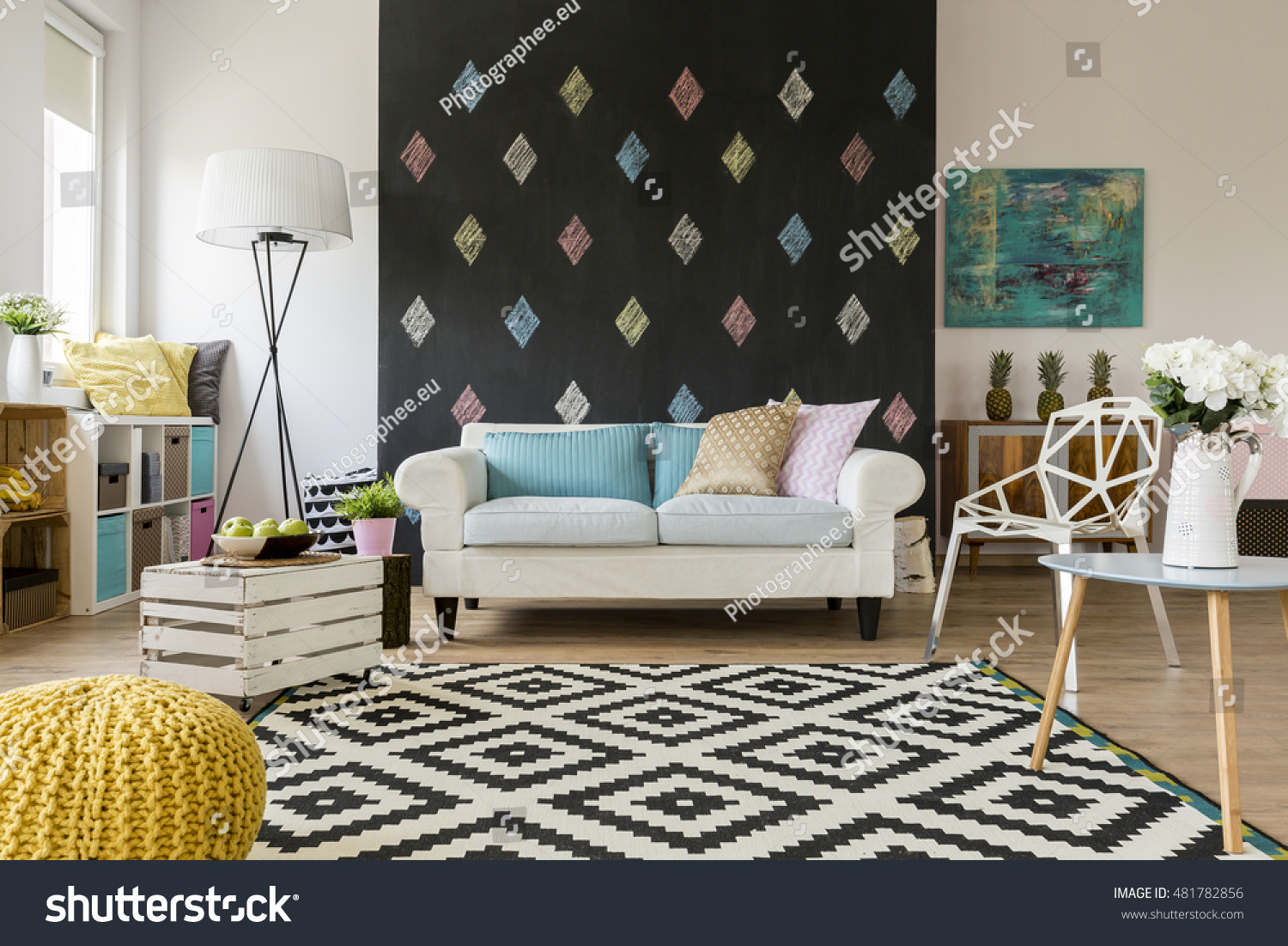 Shot of a spacious living room with a big sofa and a blackboard wall #481782856