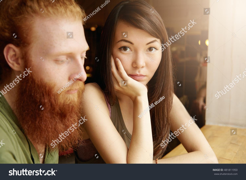 interracial couple indoor portrait freckled caucasian stock photo