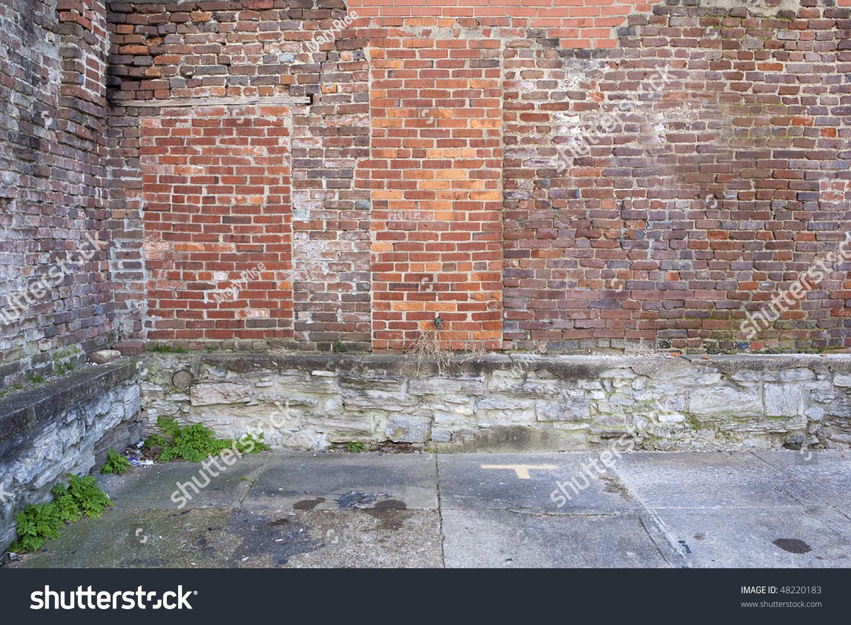 Grungy Brick Wall Parking Lot Stock Photo 48220183