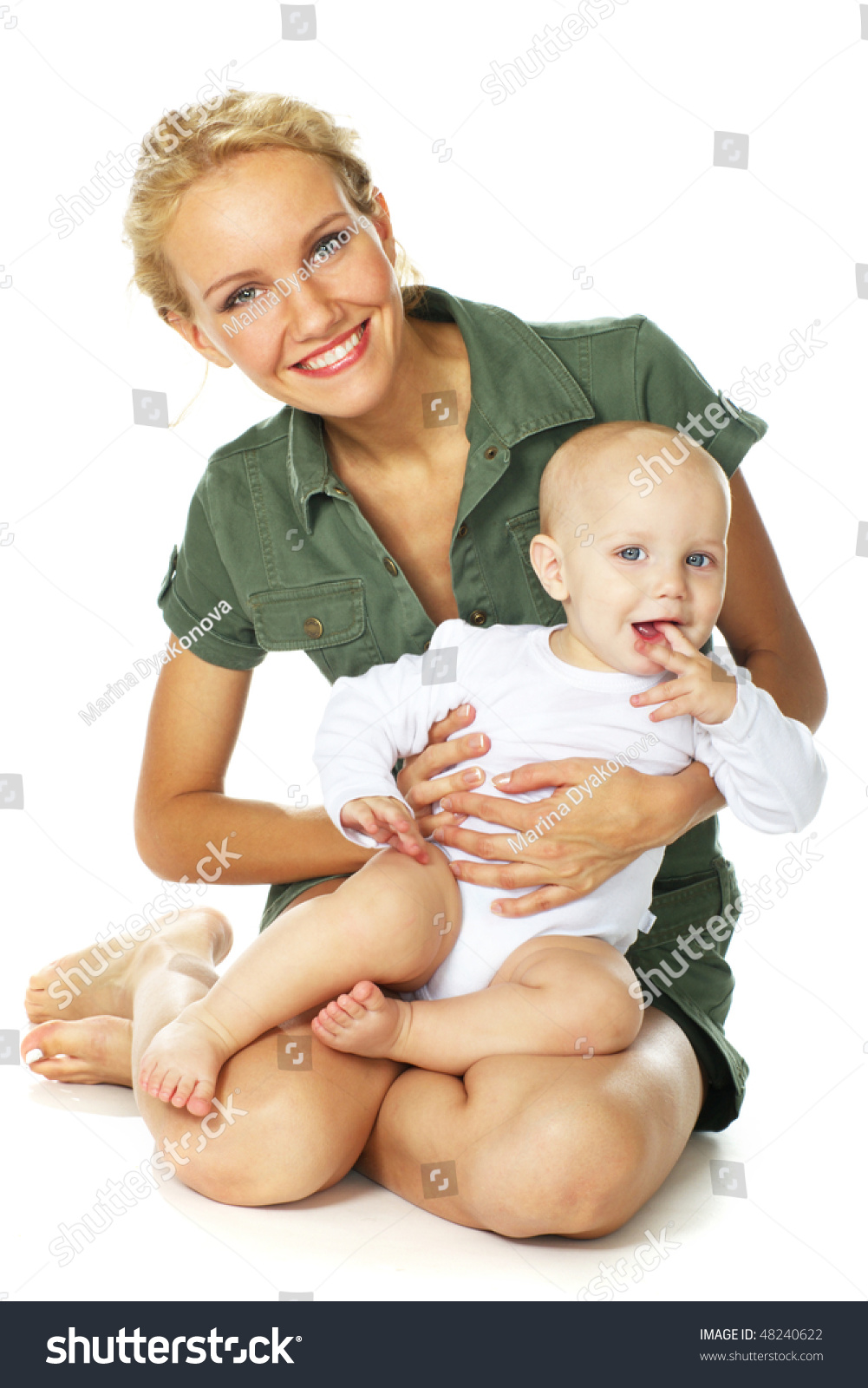 Mother Carrying Baby Boy In Sling Outdoors High-Res Stock