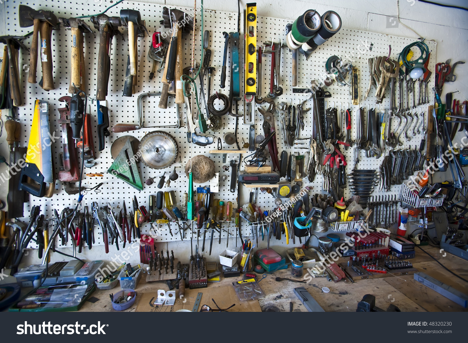 Hand Tools Organized On A Pegboard In A Home Shop Above A