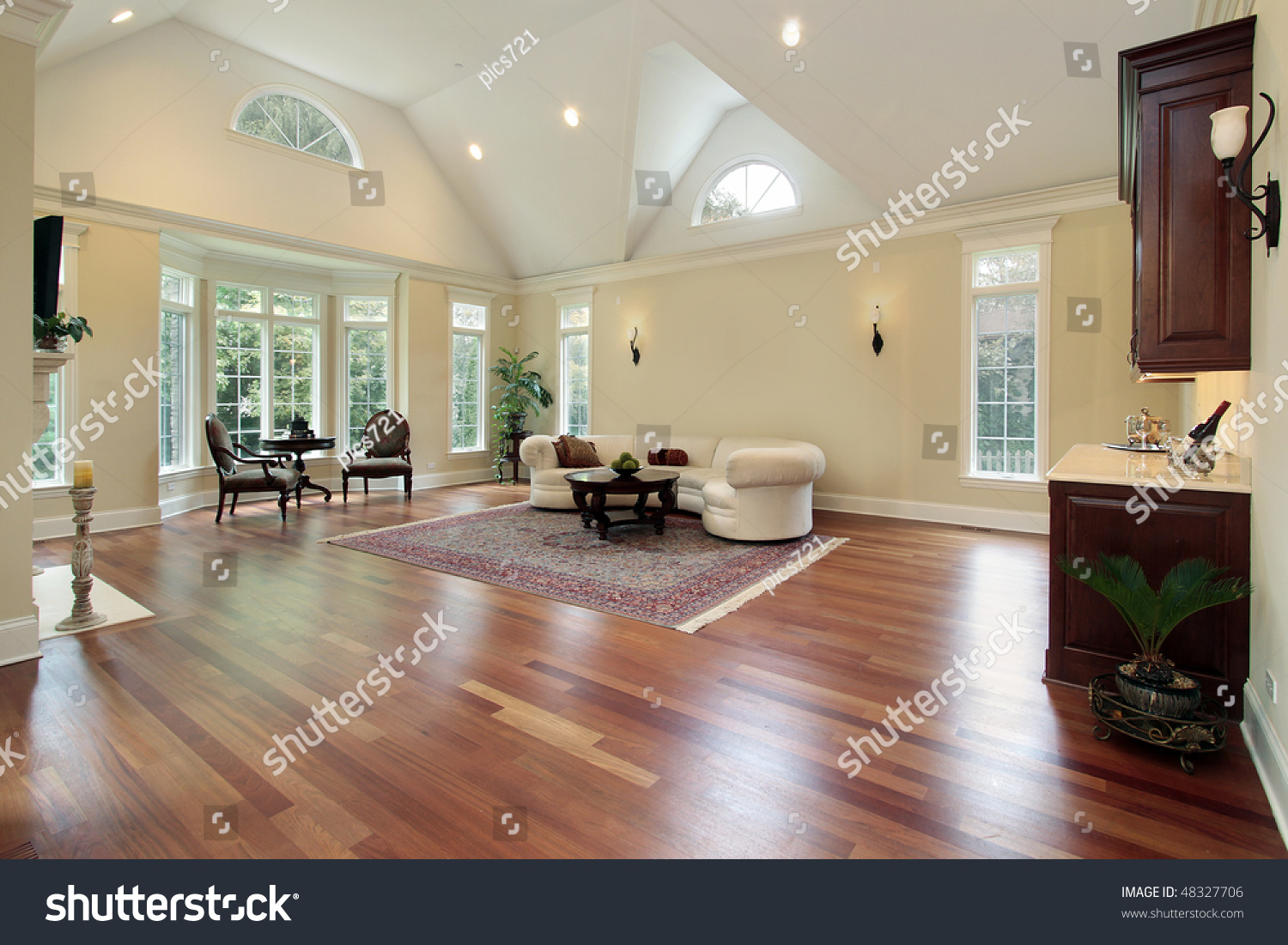 Family room luxury home curved windows stock photo for Luxury home windows
