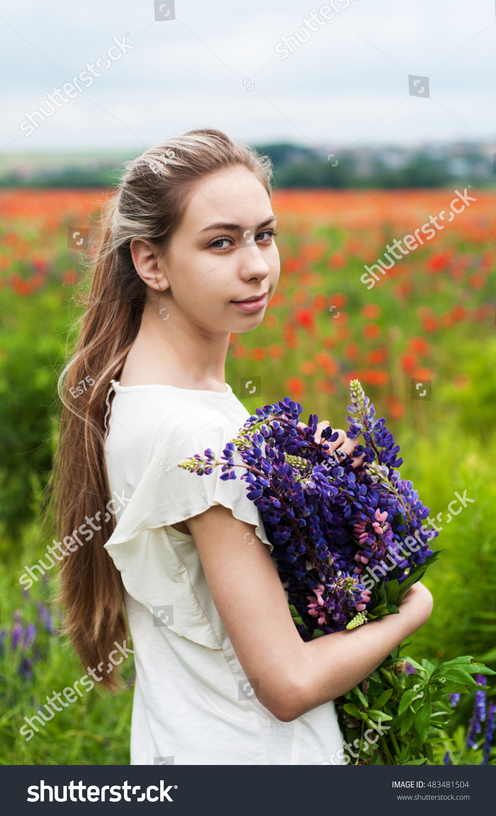 Beautiful Girl With Bouquet Of Lupine Flowers In Hands Ez Canvas