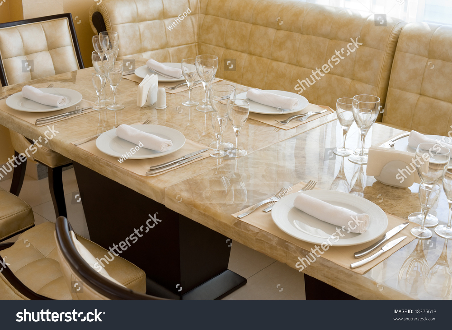 restaurant interior of beige colours with massive expensive