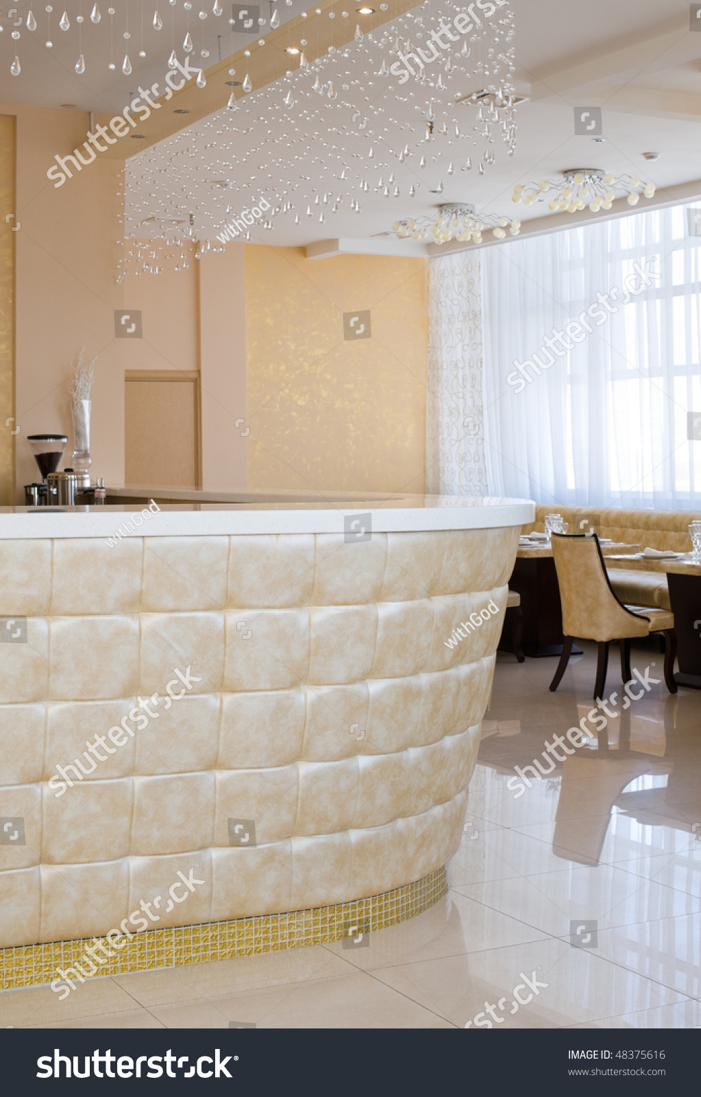 upholstered bar with crystal curtain in restaurant interior of
