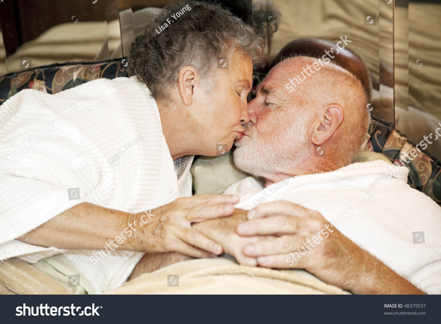 kissing couples romantic in bed romantic senior couple bed kissing goodnight stock photo 497