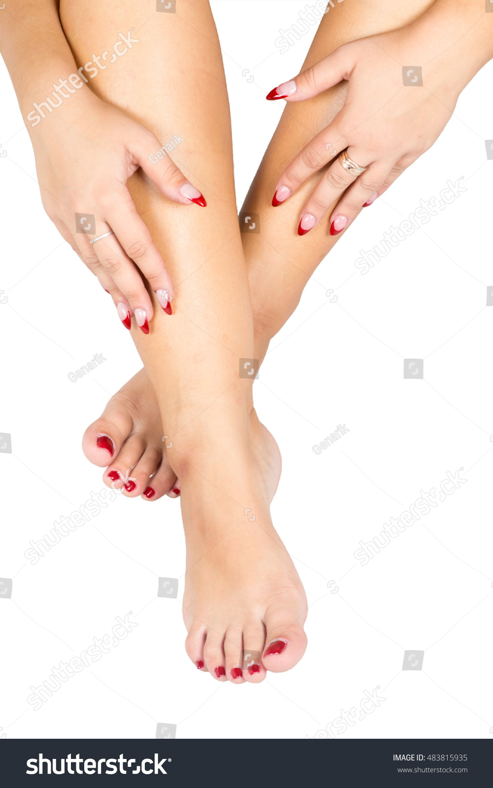beautiful female feet red pedicure hand stock photo (royalty free