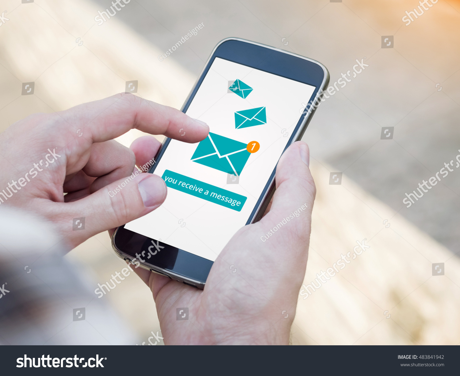 Email app on smartphone screen You receive a message New message is received Man's Hand holding a smartphone